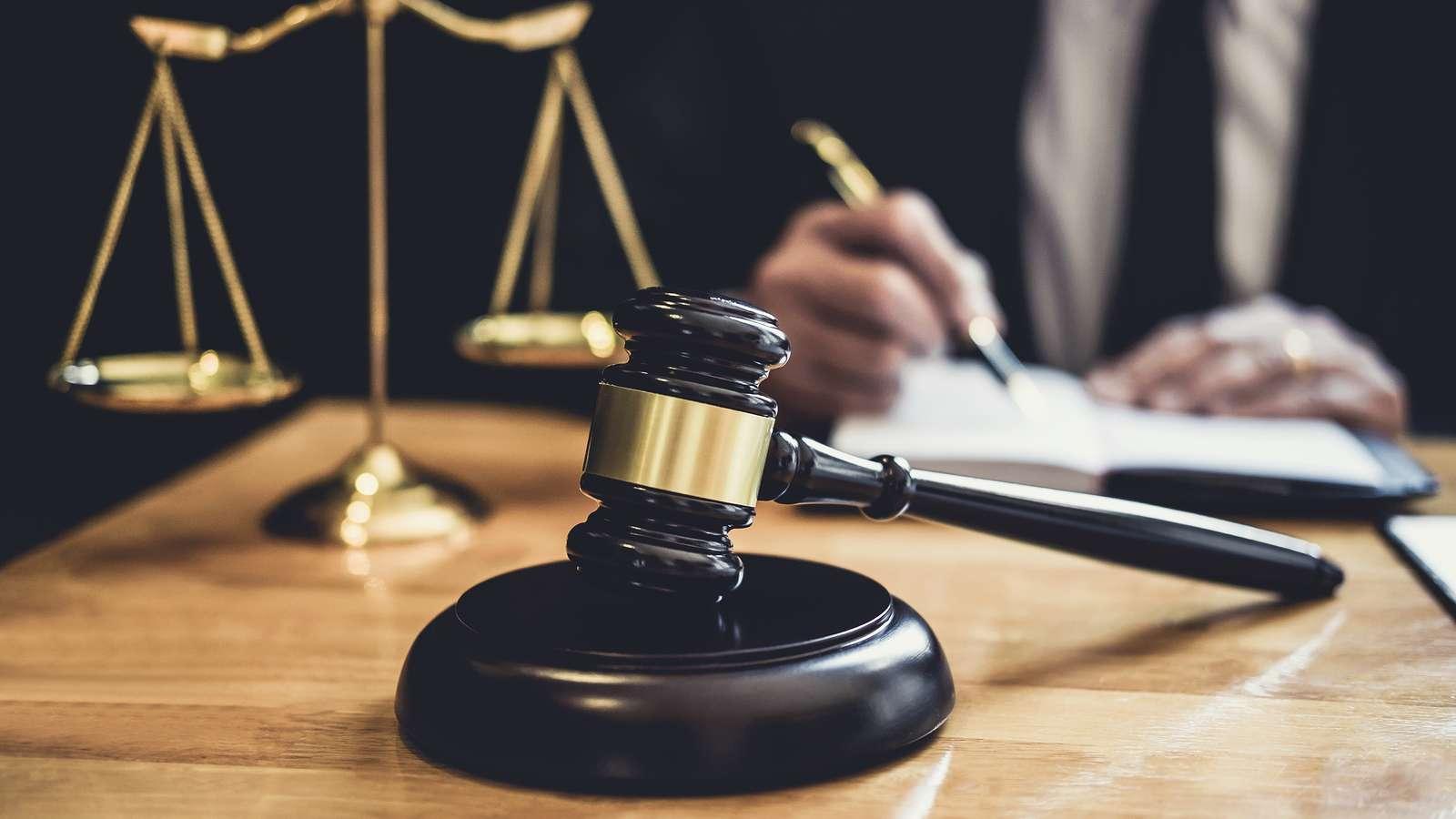 1553714785508_bigstock_male_lawyer_or_judge_working_w_271058272-1